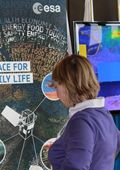 A delegate browsing the ESA stand
