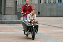 Delegates test-riding a cargo bike at the morning exhibition