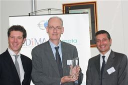 The two presidents of EDiMA and EMOTA present an award to Jean Bergevin, for services to European E-Commerce in 2011